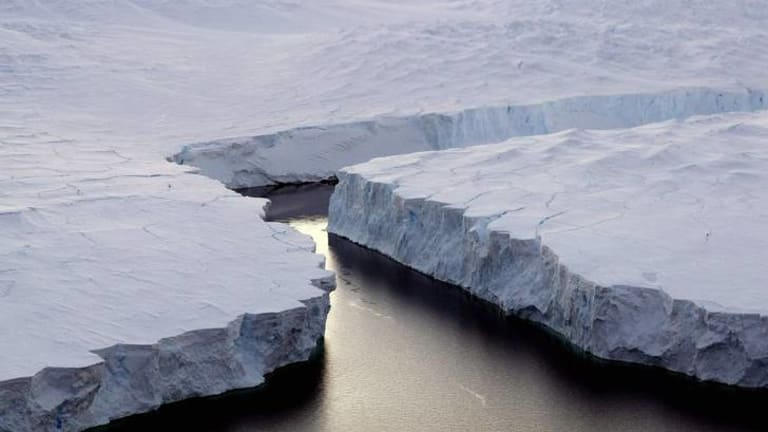 An iceberg breaks off the Knox Coast in the Antarctica.
