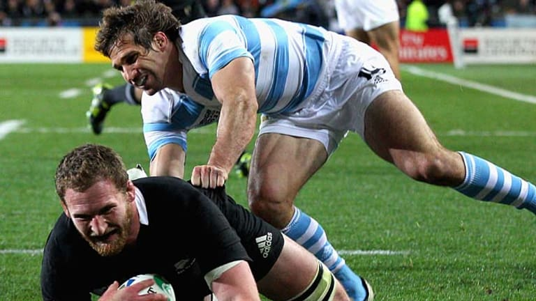 Kieran Read of the All Blacks scores his team's first try.