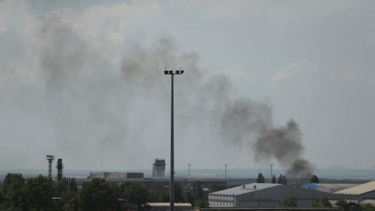 Smoke rises from inside the Donetsk airport area.