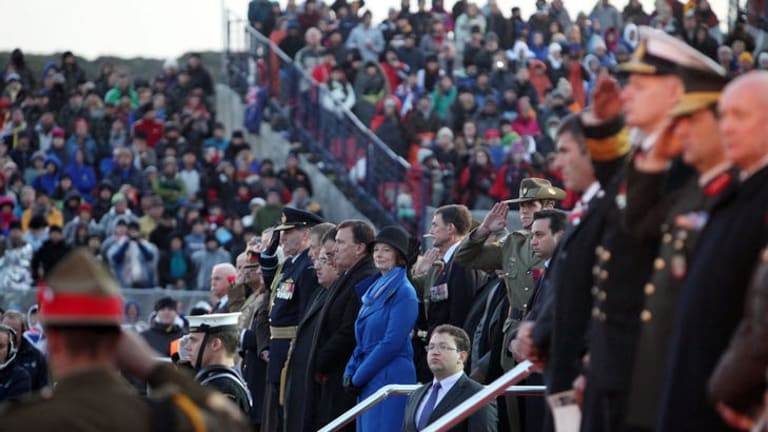 Dawn service … the Prime Minister, Julia Gillard, at Gallipoli yesterday. Corporal Ben Roberts-Smith, VC, stands behind her, saluting.