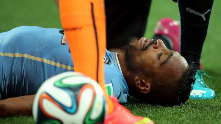 Knocked out: Alvaro Pereira of Uruguay.