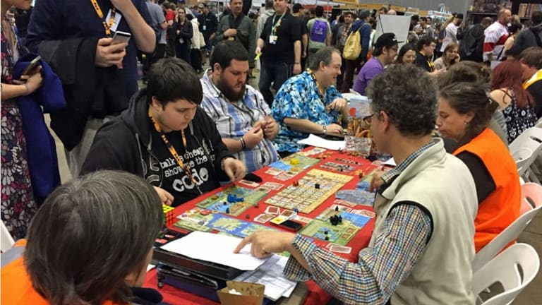 Rather than just wander past exhibits, PAX attendees are happy to sit down and invest their time in strategy games like A Feast for Odin.