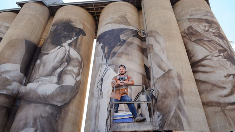 Artist Guido van Helten after putting the finishing touches on his giant mural.