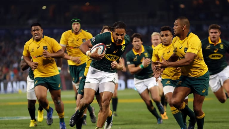 Hunted: Wallabies inside-centre Kurtley Beale sizes up South Africa's Courtnall Skosan during the Rugby Championship match at the Free State Stadium in Bloemfontein.