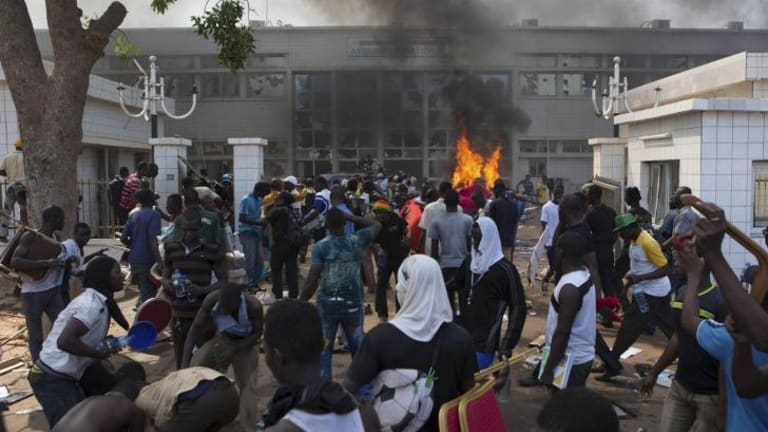 Set ablaze: Protesters set fire to the parliament building.