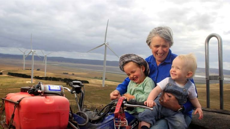 Life's a breeze … landowner Marcia Osborne with her grandchildren Kipp Osborne, 3, and Archie Davis, 15 months, on her farm near Lake George.