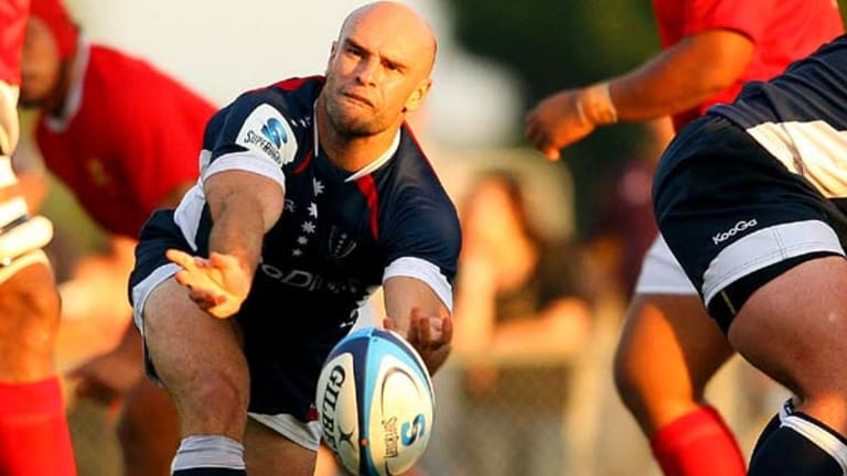 Sam Cordingley clears the ball from the breakdown for the Rebels against Tonga.