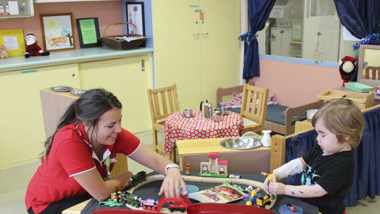 Monash Health nurse Ellie McLennan with a patient from Monash Children's Hospital.