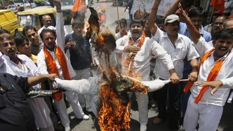 Activists of Shiv Sena, a Hindu hardline group, burn an effigy of Australian Prime Minister Kevin Rudd in New Delhi during a protest against the recent attacks on Indian students in Australia.
