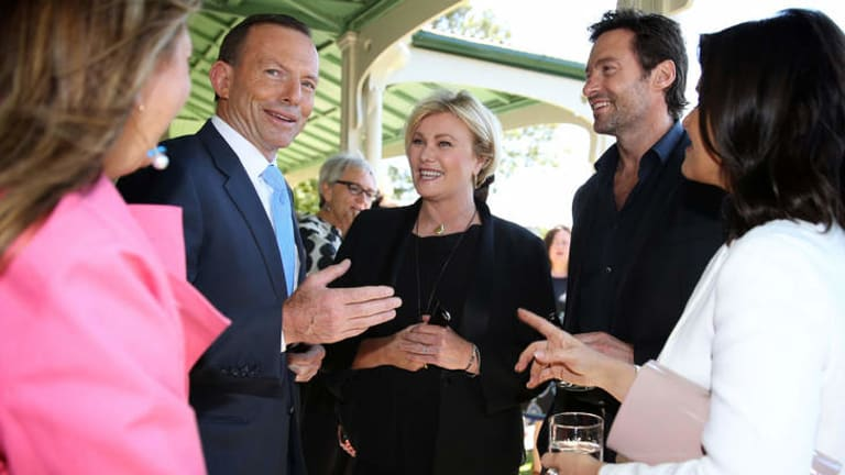 Prime Minister Tony Abbott with actors Deborah-Lee Furness and Hugh Jackman after announcing his support for making overseas adoption easier for Australian couples. An expert advisory group on adoptions was recently disbanded by the government.