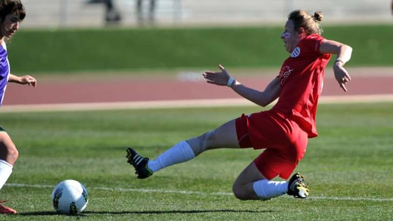 Canberra player Alicia Tupper strikes the ball in the Kanga Cup Under-19 female Cup final at the AIS.