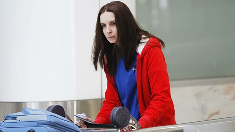 Return: Allyson McConnell arrives back in Sydney Airport on Wednesday.