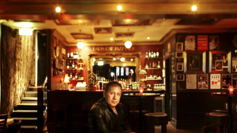 Owner Serge Carnovale soaks up the atmosphere at the Paris Cat jazz venue in Goldie Place.