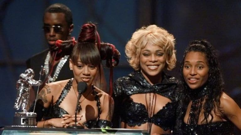 "Then there were three: (From left) TLC's Lisa ""Left Eye"" Lopes with T-Boz and Chilli accepting an MTV award in 1999, with Sean Combs behind."