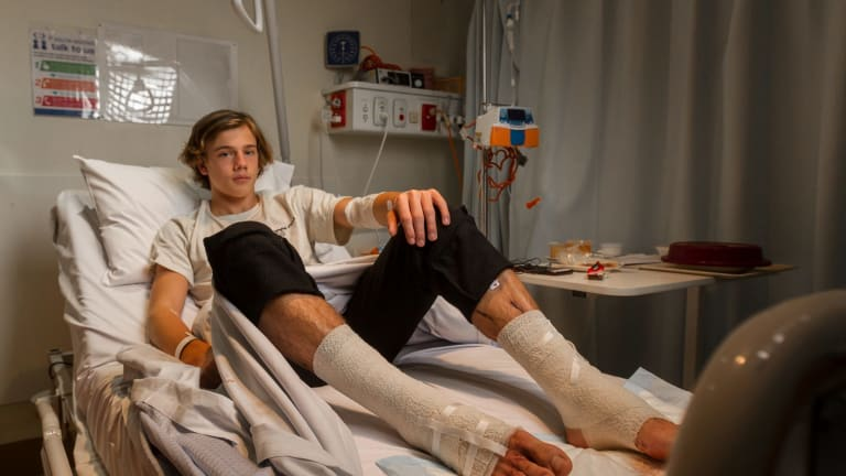 Sam Kanizay rests in hospital after being bitten while soaking his legs after a footy match.
