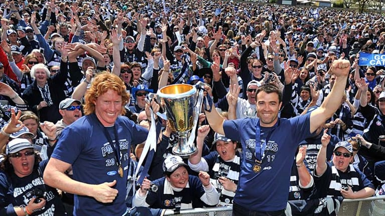 Great day: Geelong fans showed no signs they are tired of premiership celebrations when thousands turned out at Kardinia Park yesterday to see the cup and their heroes led by captain Cameron Ling and coach Chris Scott.