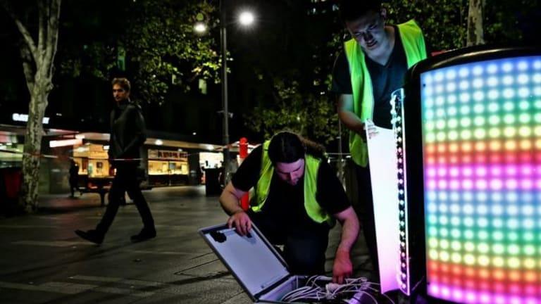 Sam Johnson (left) and Steven Bai (right) install their Tetrabin ahead of the launch of Vivid LIGHTS.