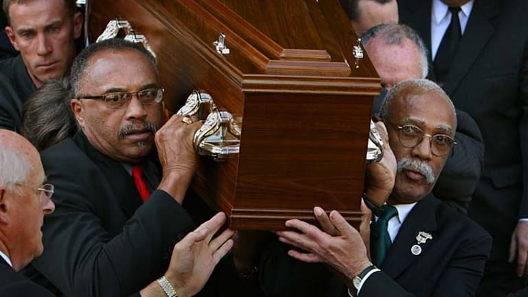 US athletes Tommie Smith,  left,  and John Carlos carry Peter Norman's coffin from the Williamstown Town Hall on  October 9, 2006.