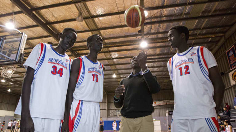 Making a fresh start: Mayor Chagai with his team of Sudanese youth at Kevin Betts Stadium, Mt Druitt.