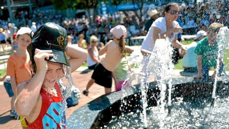 Kids cool down by the fountain at the Australian Open.