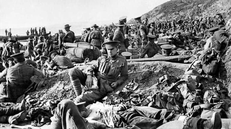An Australian soldier lies wounded at Anzac Cove on the day of the Gallipoli landing, April 25, 1915. This scene is looking along the beach to the north. Photo: Philip Schuller (The Age Gallipoli Pictures).