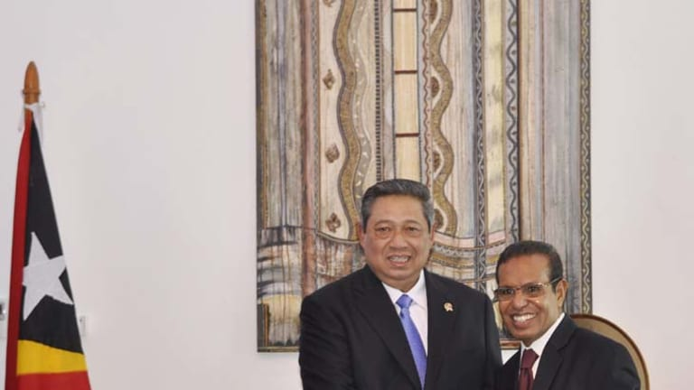 Supportive … new President, Taur Matan Ruak, right, is congratulated yesterday by Indonesia's Susilo Bambang Yudhoyono.