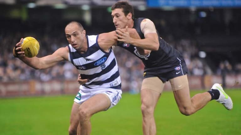 Geelong's James Podsiadly competes for the ball with Carlton's Michael Jamison.