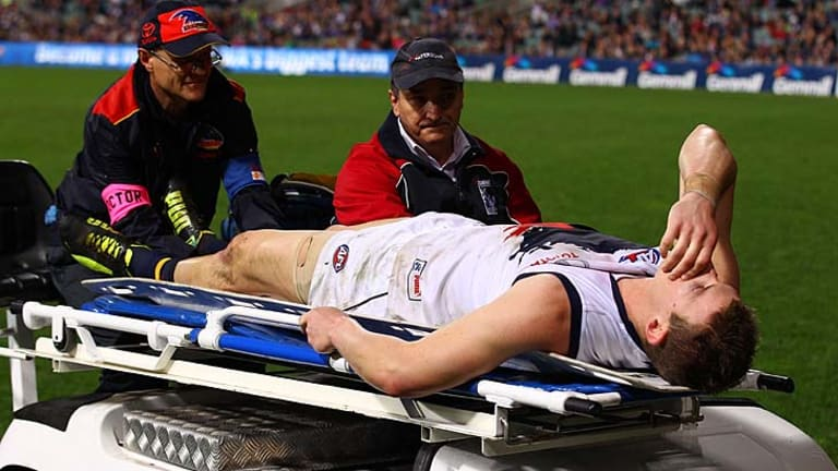 Josh Jenkins is stretchered off the ground.
