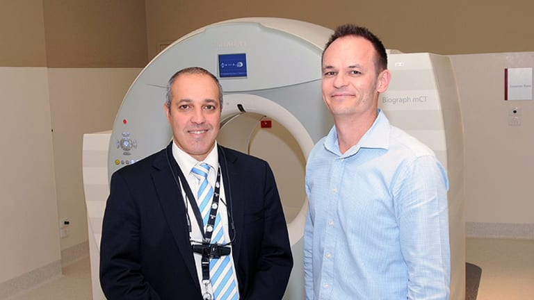 Doctor Sandro Porceddu and Paul Hunter with the new $4 million PET-CT scanner at Princess Alexandra Hospital.