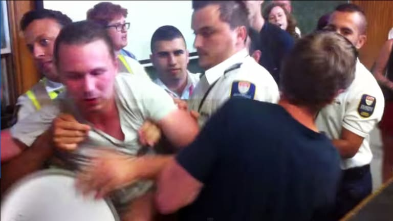 A screen grab from a YouTube video of the protest at the University of Sydney.