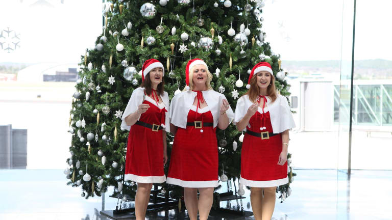 the o christmas trio singing christmas carols at the canberra airport - Christmas Carollers