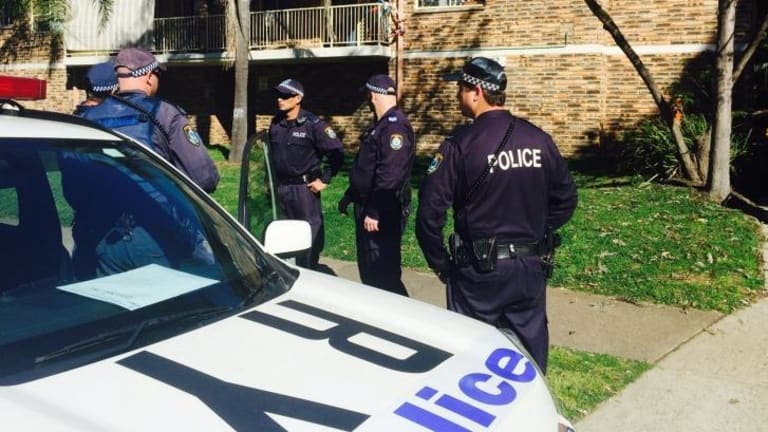 Police raid the Wentworthville unit.
