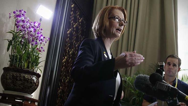 Prime Minister Julia Gillard speaks at Sanya airport.