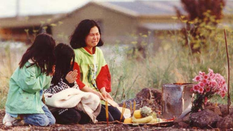 Phyllis Chan and her daughters perform a service for Karmein in May 1992 at the spot where her body was discovered in Thomastown