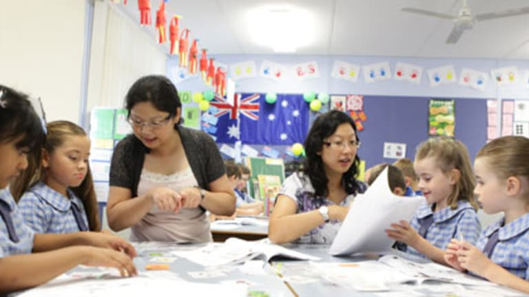 Great leap forward ... Rouse Hill Public School Mandarin students with teachers Ginny Lim (left) and Lily Fang, a volunteer from China.