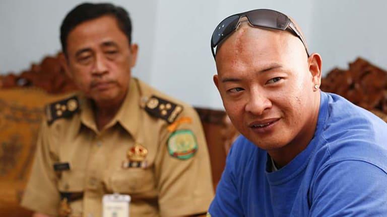 Still upbeat on death row: Bali nine ringleader Andrew Chan and Kerobokan prison governor Siswanto.