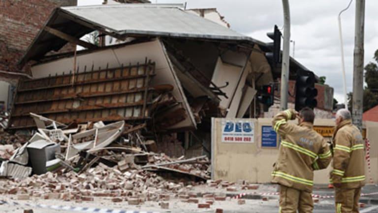The collapse sent bricks and debris tumbling across the street.