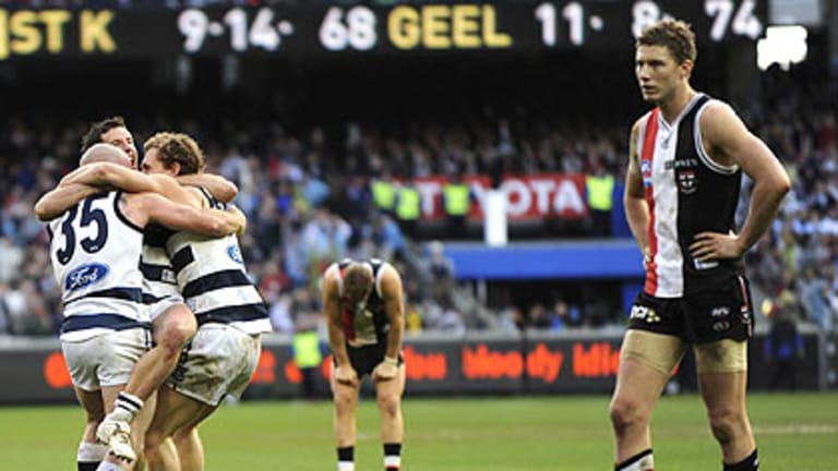 Geelong players celebrate last year's grand final win.