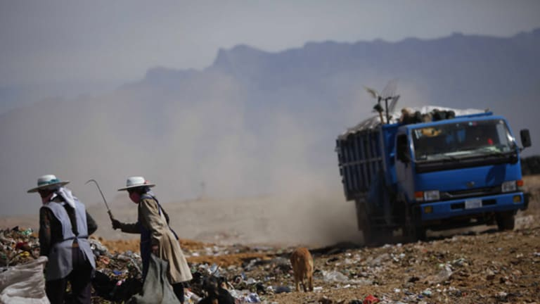 Women gather unrecycled rubbish at a dump outside Cochabamba where the World People's Conference on Climate Change and the Rights of Mother Earth is being held.