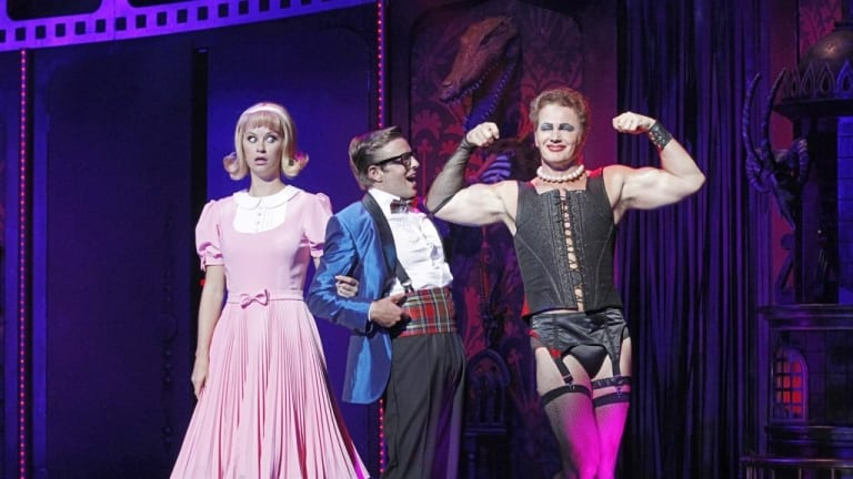Craig McLachlan (right) as Frank-N-Furter in The Rocky Horror Show.