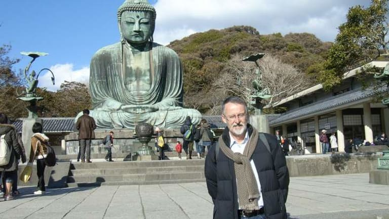 Dr Michael Pearson in front of the Amitabha Buddha, Kamakura, Japan.