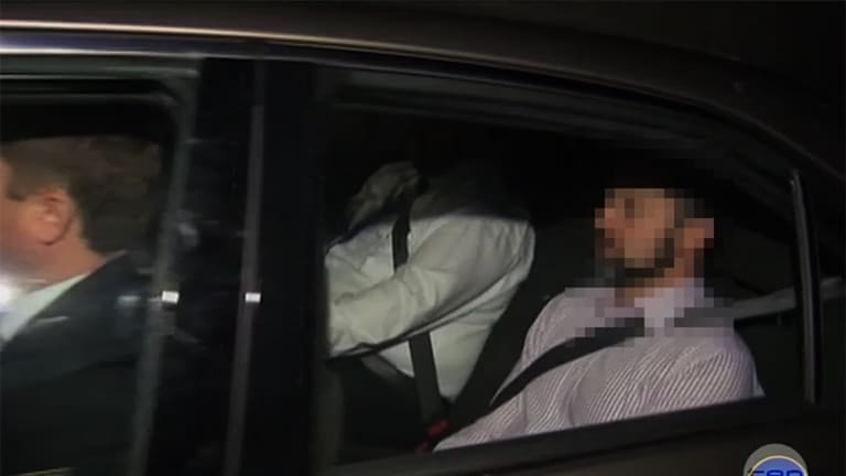 Police take Gerard Baden-Clay away to be charged with the murder of his wife Allison. Screengrab from Channel 10.