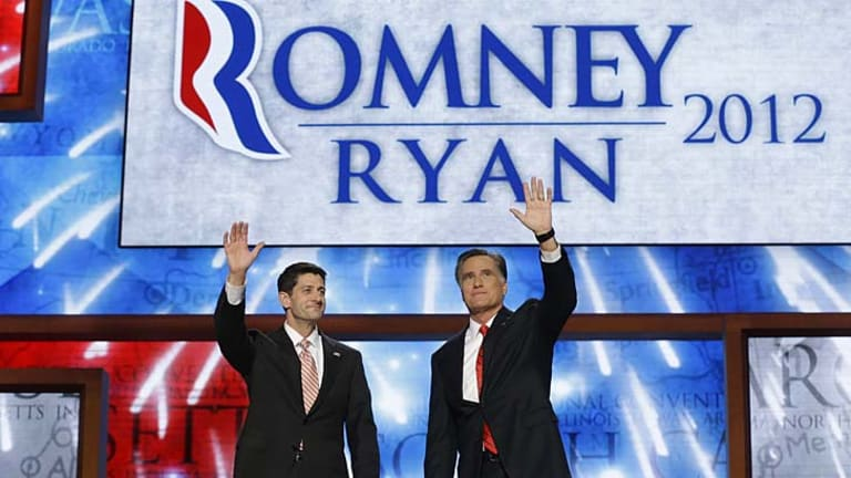 Dog whistle racism ... Republican presidential candidate Mitt Romney, right, and his vice-presidential candidate Paul Ryan.