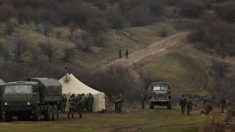 Pro-Russian forces near the road leading towards the entrance of the Ukrainian military base in Perevalnoye.
