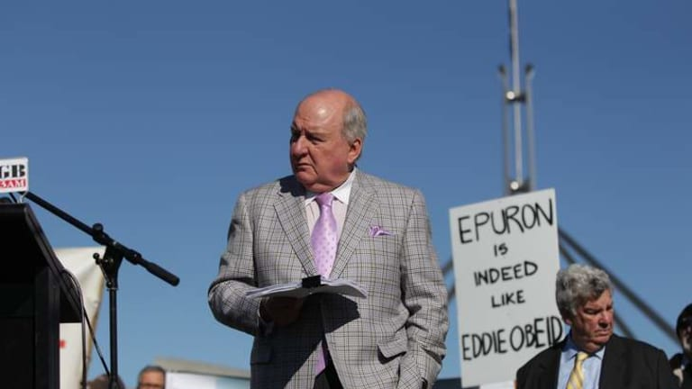 Broadcaster Alan Jones at the anti-wind farm rally out the front of Parliament House in Canberra in June .