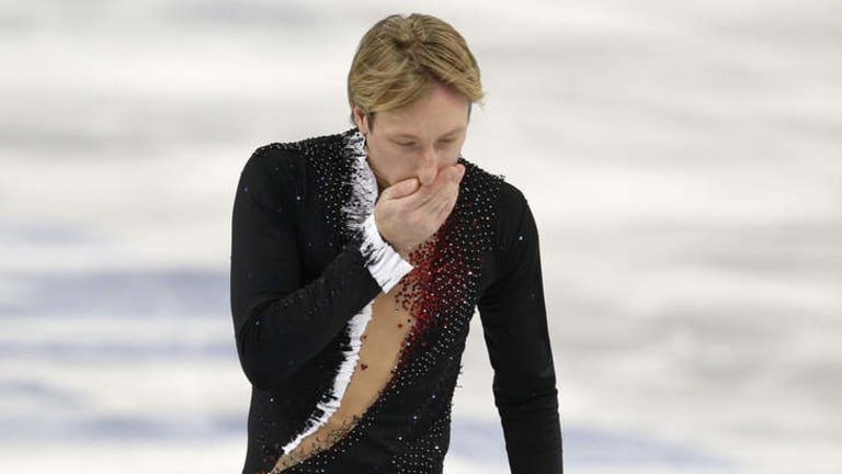 End of a career ... Russian Evgeni Plushenko leaves the ice after pulling out of the men's short program figure skating competition due to injury at the Iceberg Skating Palace.