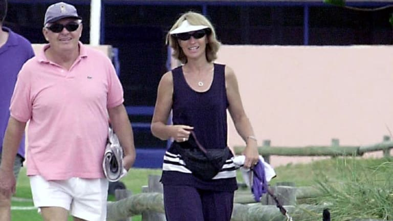Alan Bond takes a walk near his home in Cottesloe with wife, Di Bliss and pet dog.