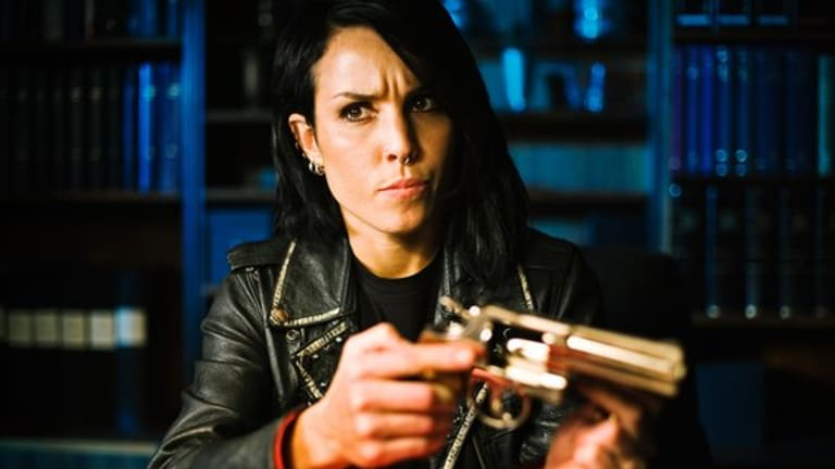 Lock and load! Swedish Goth girl Lisbeth Salander (Noomi Rapace) gets ready for action in the painfully bad The Girl Who Played With Fire.