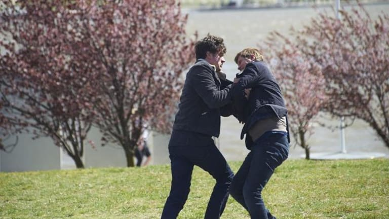 ABC TV political thriller The Code will return for a second season. Hacker Jesse Banks, played by Ashley Zukerman, wrestles with AFP officer Lyndon Joyce, Dan Wyllie, on the shores of Lake Burley Griffin.