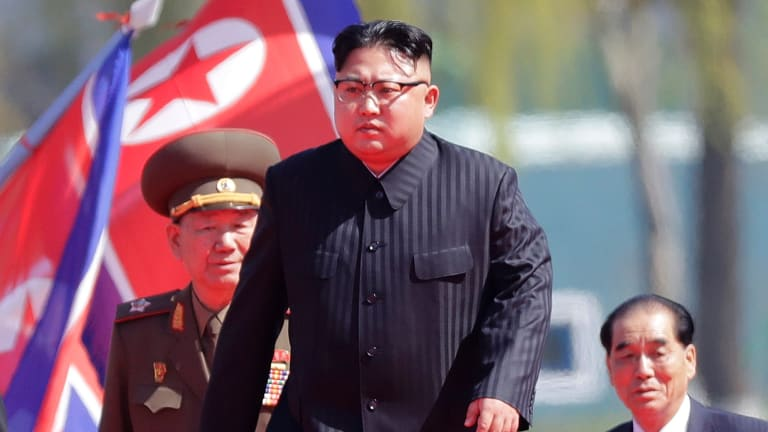 North Korean leader Kim Jong-un, centre, has consumed world attention with his regime's recent missile launches.